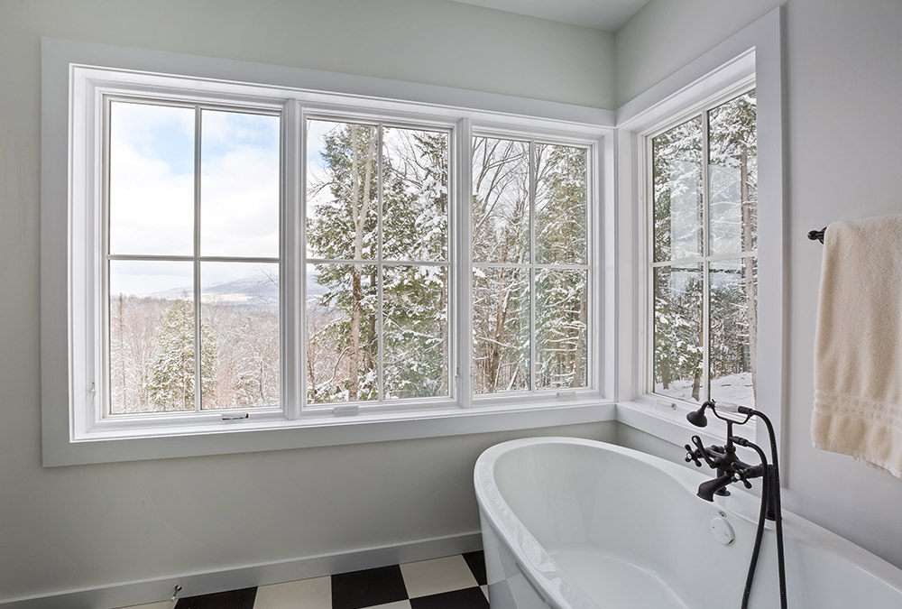 picture of the bathtub and windows with view to mountains